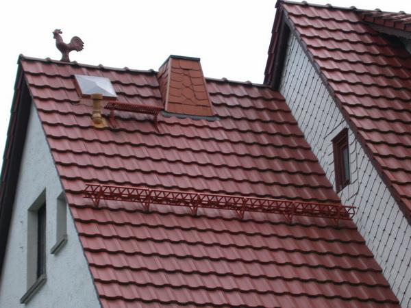 Крыша частного дома из металлочерепицы