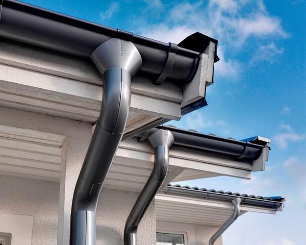 Металлические водосточные трубы для крыши коттеджа
